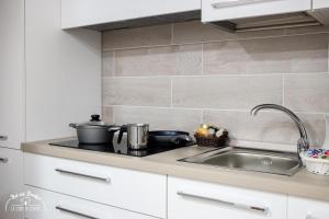 A kitchen or kitchenette at b&b la corte in centro