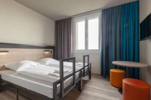 Cama ou camas em um quarto em ao Hotel Venezia Mestre 2