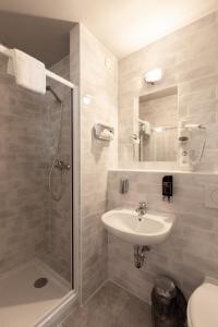 Um banheiro em ao Hotel Venezia Mestre 2