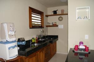 A kitchen or kitchenette at APARTAMENTO GUARAMIRANGA - MONTE VERDE