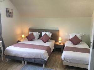 Un ou plusieurs lits dans un hébergement de l'établissement B&B de Saint Come de Fresné