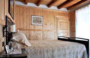 Een bed of bedden in een kamer bij B&B Aquarelle