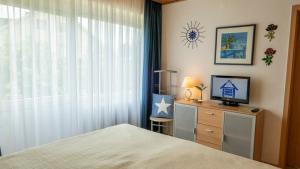 Ein Bett oder Betten in einem Zimmer der Unterkunft Gästehaus Guter Stern