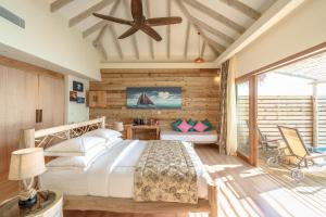 A bed or beds in a room at You & Me Maldives