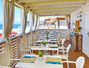 A restaurant or other place to eat at Hotel Garden Riviera