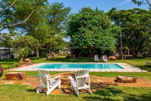 The swimming pool at or close to Biweda Nguni Lodge and B&B