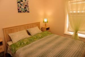 Кровать или кровати в номере Apartment VLcome Rooms