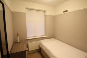 A bed or beds in a room at Oak Tree
