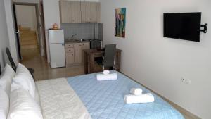 Ένα ή περισσότερα κρεβάτια σε δωμάτιο στο Violetta Studios
