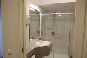 Uma casa de banho em Hotel Solar do Rebolo