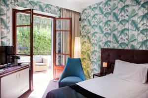 Letto o letti in una camera di Hotel Esplendido