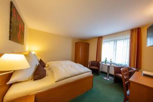 Een bed of bedden in een kamer bij Hotel Burgfrieden