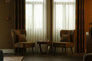 Uma área de estar em Hotel Solar do Rebolo