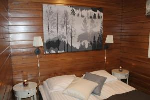 A bed or beds in a room at Loma-Vietonen Holiday Village