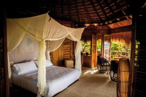 A bed or beds in a room at Hotel Las Islas