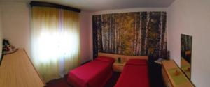 A bed or beds in a room at Appartamento Al Cortile
