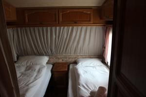 A bed or beds in a room at Camping Denis