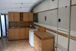 A kitchen or kitchenette at Camping Denis