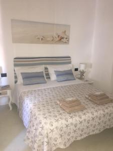 Cama ou camas em um quarto em Oltremare