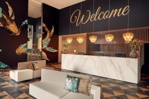 Лобби или стойка регистрации в Van der Valk Hotel Beveren
