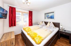 Ein Bett oder Betten in einem Zimmer der Unterkunft Appartement Pension Albert