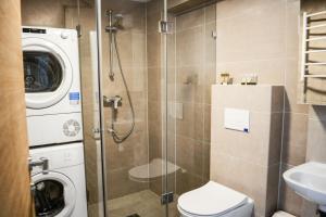 Vonios kambarys apgyvendinimo įstaigoje Auros apartamentai