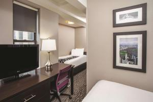 A television and/or entertainment center at La Quinta by Wyndham New York City Central Park
