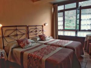 Cama o camas de una habitación en La Corona del Auteiro