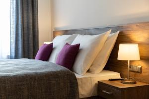 Letto o letti in una camera di Hotel Melantrich