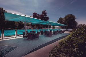 The swimming pool at or close to Regent Hotel By The Lake