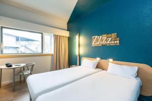 Un ou plusieurs lits dans un hébergement de l'établissement ibis budget Paris Porte de Pantin