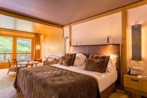 A bed or beds in a room at Sport Hotel Hermitage & Spa