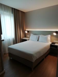 Uma cama ou camas num quarto em ClipHotel
