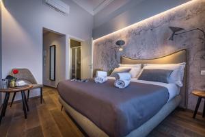 Letto o letti in una camera di Palazzo dei Conti Residenza d'Epoca