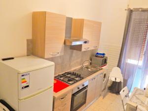 A kitchen or kitchenette at B&B RESTO AL SUD