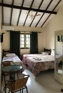 A bed or beds in a room at Itaipava Cama e Café