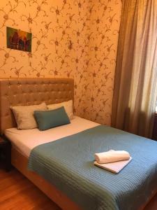 Кровать или кровати в номере Kutuzov House on Kutuzovsky prospekt