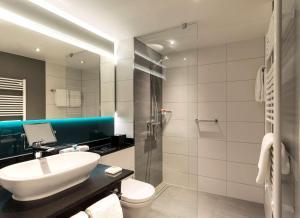 Een badkamer bij Hyatt Place Frankfurt Airport