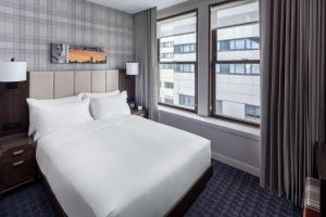 A bed or beds in a room at Hyatt Centric Faneuil Hall Boston