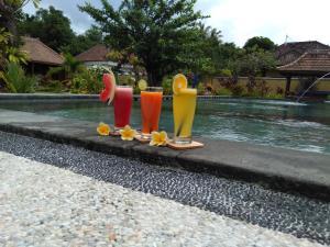 The swimming pool at or near Kubu Kangin Resort