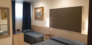 Letto o letti in una camera di Hotel Chopin