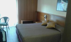 A bed or beds in a room at Hotel Sila