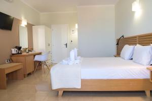 Letto o letti in una camera di Mithos Premium Rooms