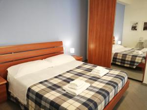 Un ou plusieurs lits dans un hébergement de l'établissement Il Centro