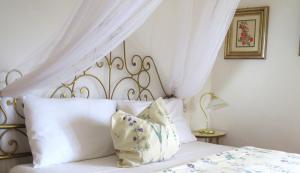 Letto o letti in una camera di Casa S Tomè Nago Torbole