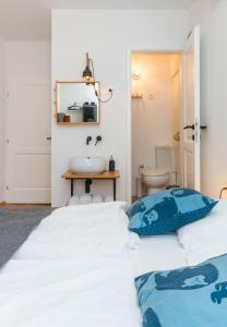 A bed or beds in a room at Little Tower by Locap Group