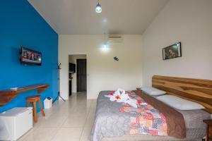 Cama o camas de una habitación en Hotel Secreto La Fortuna