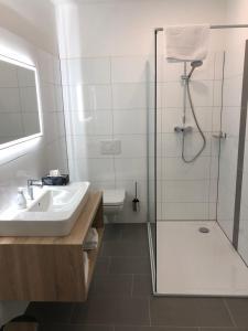 A bathroom at Burbaums Restaurant Hotel