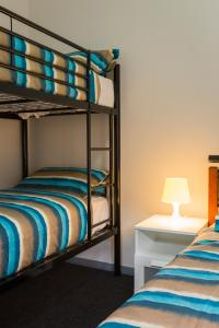 A bunk bed or bunk beds in a room at Fremantle Prison YHA
