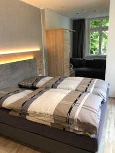 A bed or beds in a room at Burbaums Restaurant Hotel